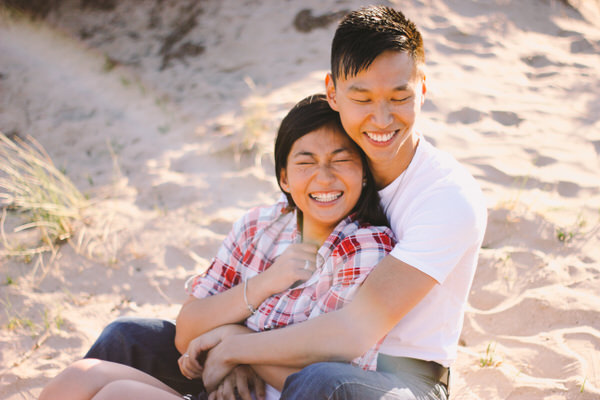 Couple sitting in sand
